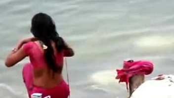 Indian woman Medicine lavage in all directions ganges river backless open